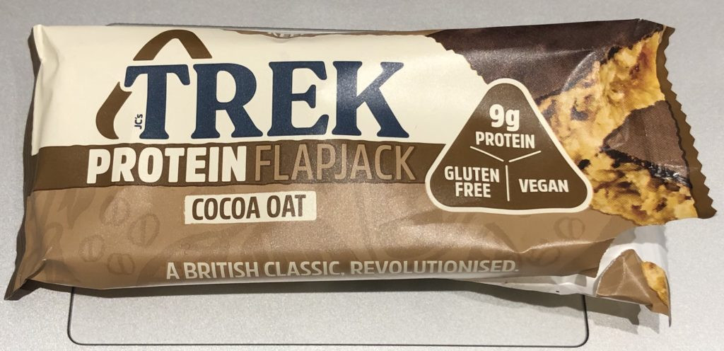 A Trek protein bar wrapper.